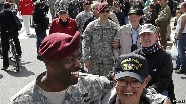 American veterans joined by serving soldiers