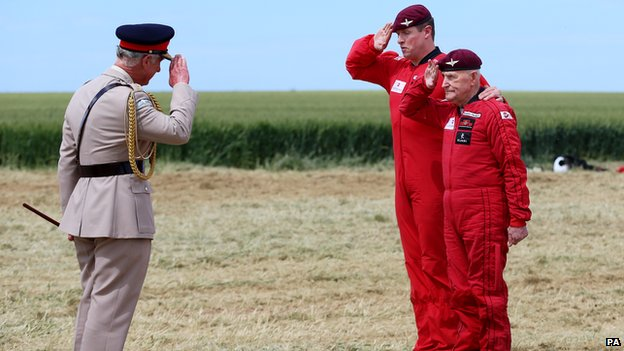 Prince Charles saluting Jock Hutton before his parachute jump