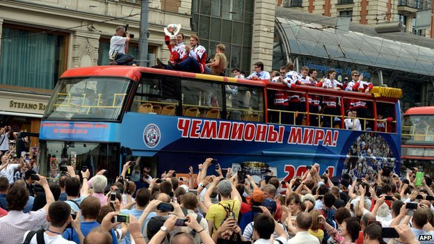 People greet buses carrying Russia's ice hockey team in Moscow