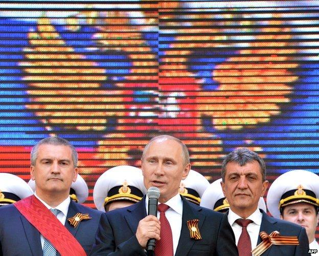 Russian President Vladimir Putin speaks during his visit to the Crimean port of Sevastopol