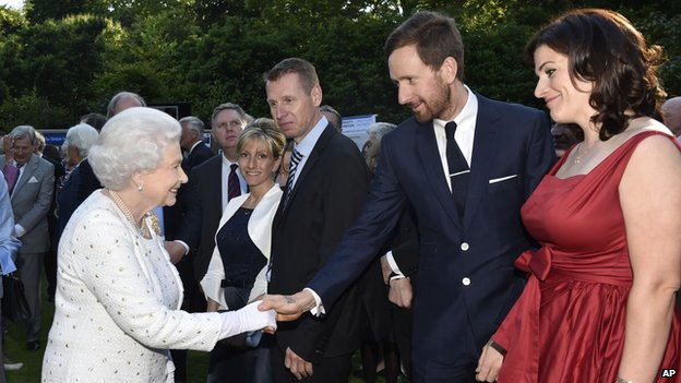 The Queen shaking hands with Sir Bradley Wiggins