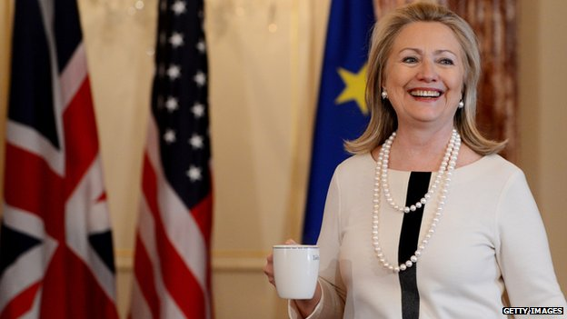 Clinton holds a coffee mug at the state department in Washington