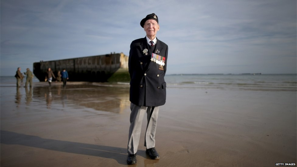 Bill Price, aged 99, on a beach in France