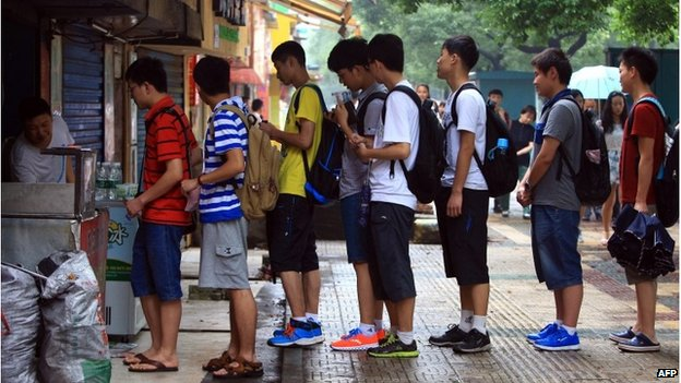Students line up to buy meat pies