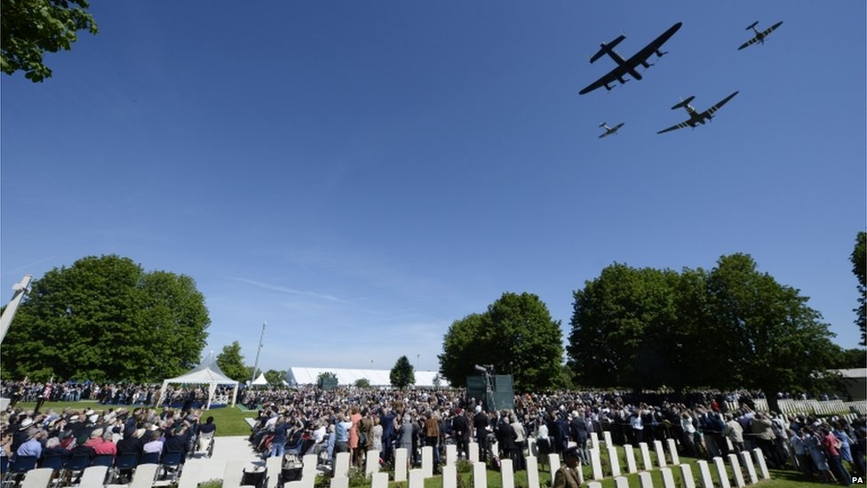 The fly-past before the Service of Remembrance at the Commonwealth War Graves Commission Cemetery, Bayeux