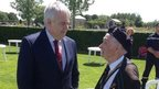 Carwyn Jones with veteran in Normandy