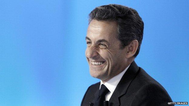 Sarkozy smiling