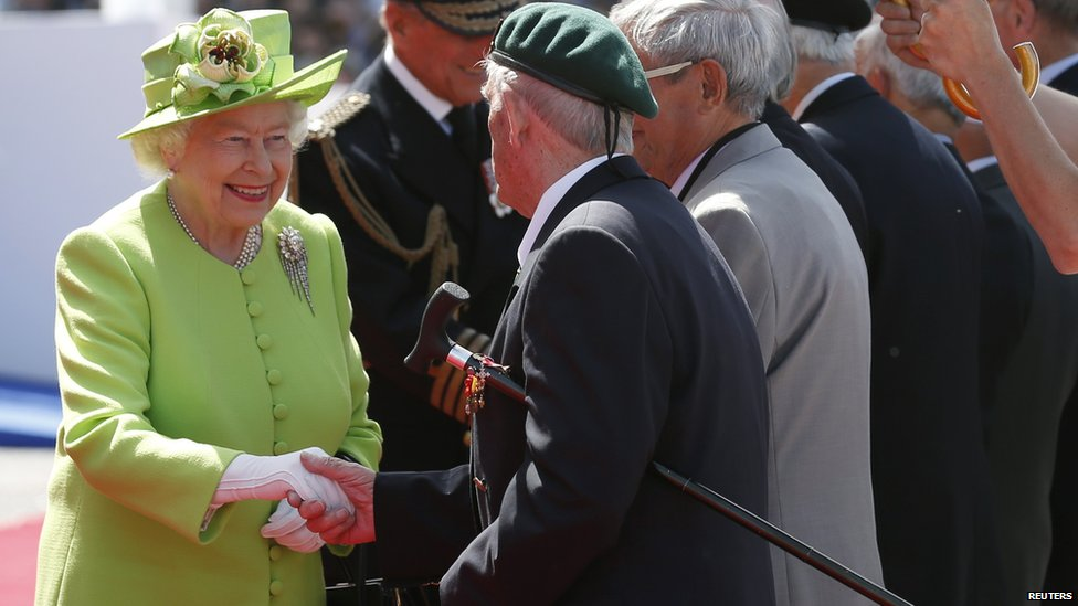 The Queen and the Duke of Edinburgh greet veterans at the International 70th D-Day Commemoration Ceremony at Sword Beach in Ouistreham