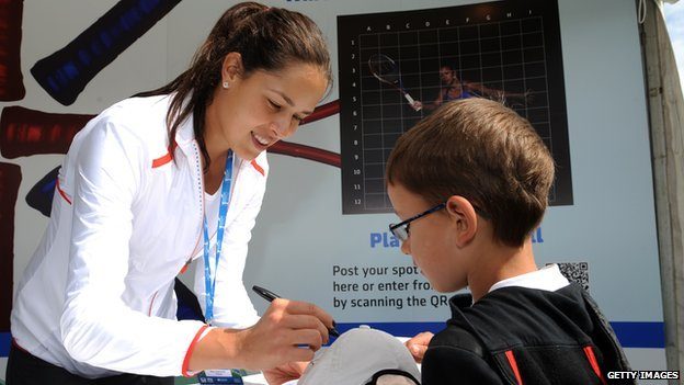 Ana Ivanovic signing an autograph for a boy in 2012
