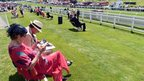 Racegoers study the form