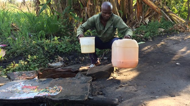 A man collecting water in Nelspruit - South Africa