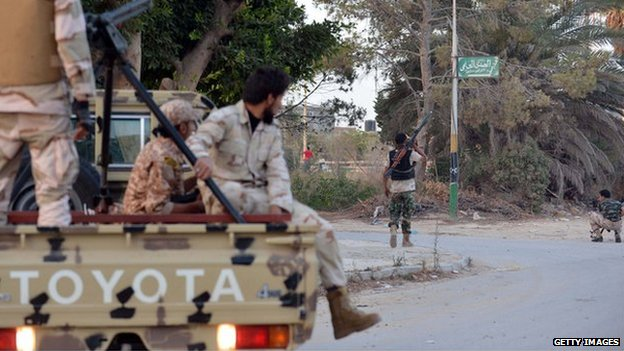 Libyan militiamen loyal to rogue general Khalifa Haftar take position during clashes against Islamists in the eastern Libyan city of Benghazi on June 2, 2014 which left at least 18 people killed.