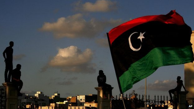 Libyans watch the protest against Ansar al-Shariah Brigades and other Islamic militias, in Benghazi, Libya, Friday, Sept. 21, 2012.