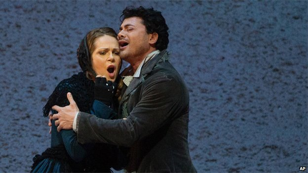 Vittorio Grigolo portrays Rodolfo with Kristine Opolais as Mimi in the Metropolitan Oper's Live in HD broadcast of Puccini's La Boheme, April 2014