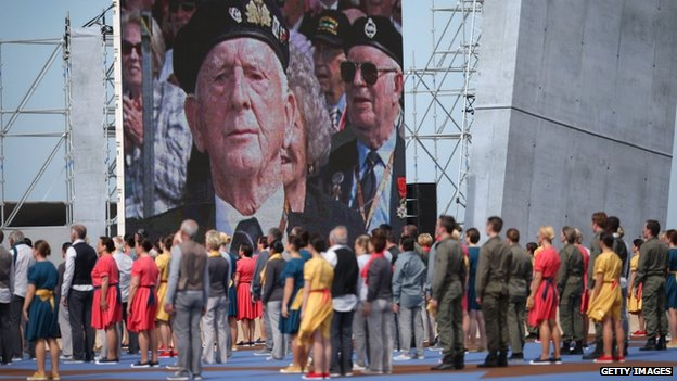 A screen at the Sword Beach ceremony