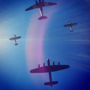 Vintage planes in blue skies with halo effect