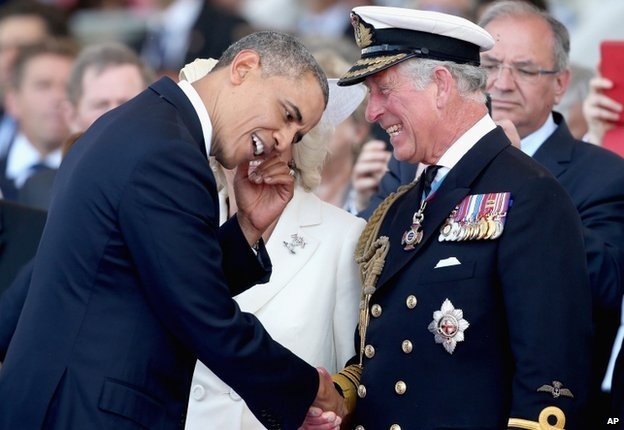 Britain's Prince Charles, right, laughs as he meets US President Barak Obama,