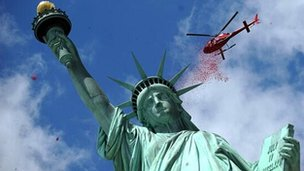 Petals fall over Lady Liberty