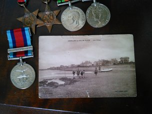 Postcard and medals