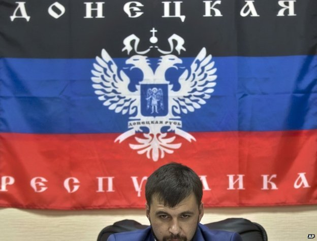 Pushilin with the Donetsk Republic flag