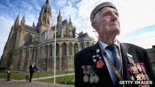 88-year-old Victor Walker, formerly of HMS Versatile, outside Bayeux Cathedral