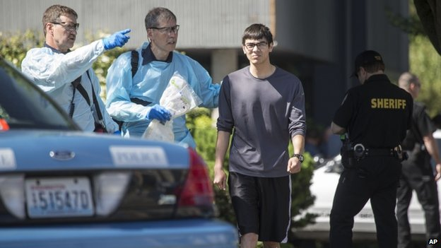 Jon Meis (centre) is taken from the shooting scene by medics at Seattle Pacific University on 5 June 2014 2014