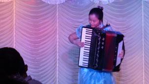 waitress playing accordion