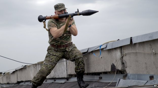 A pro-Russian fighter prepares to launch a rocket propelled grenade during clashes near Luhansk, eastern Ukraine. Photo: 2 June 2014