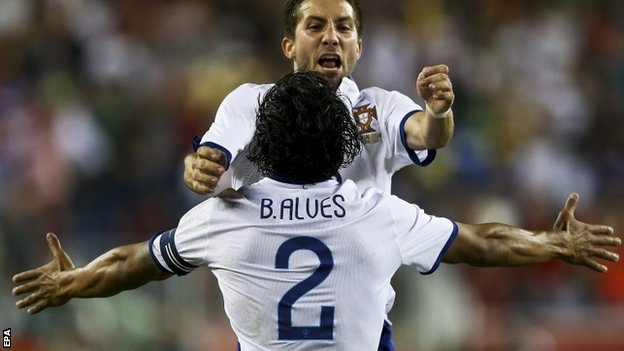 Joao Moutinho and Bruno Alves celebrate