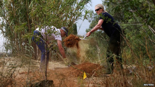 Officers clearing scrubland