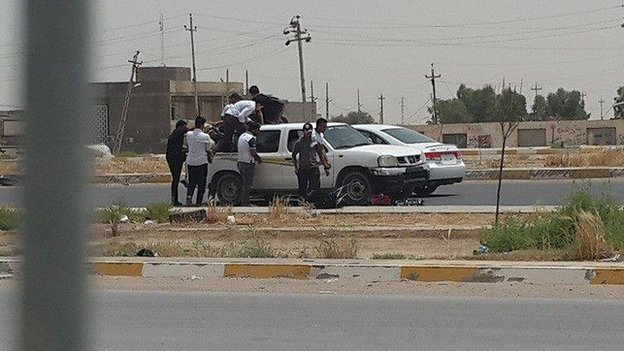 Students board vehicles at Anbar University, 7 June