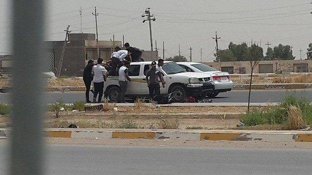 Students board vehicles at Anbar University, 7 June