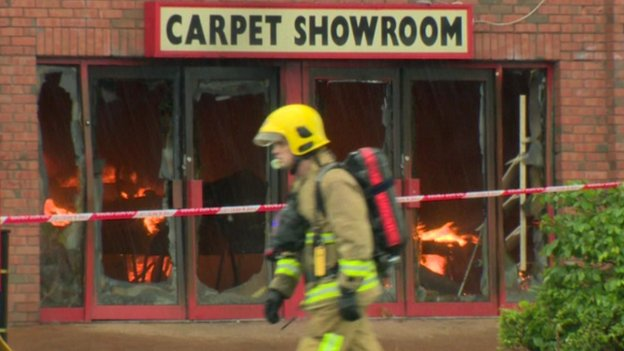Firefighter at Carpetright blaze