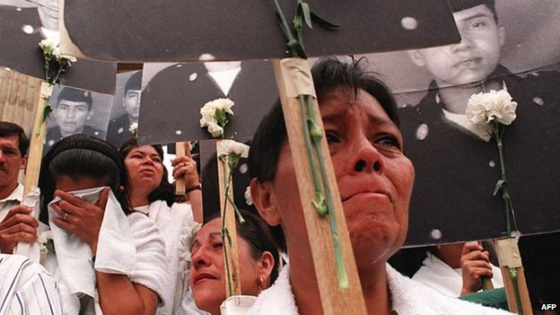 Relatives of Farc victims march in Bogota, 19 May 14
