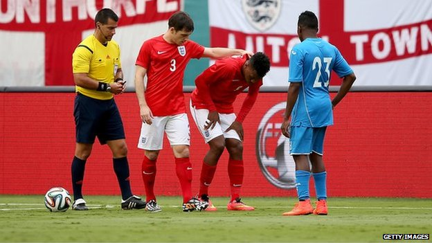 England striker Daniel Sturridge (second right) in pain during the 0-0 draw with Honduras