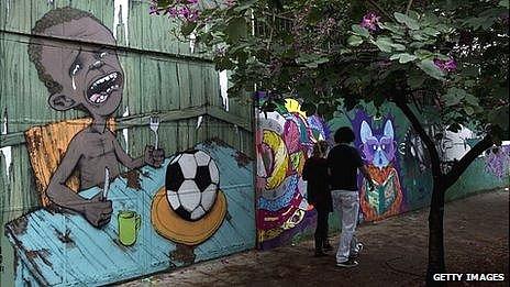 Graffiti painted by Brazilian street artist Paulo Ito on the entrance of a public schoolhouse in Sao Paulo