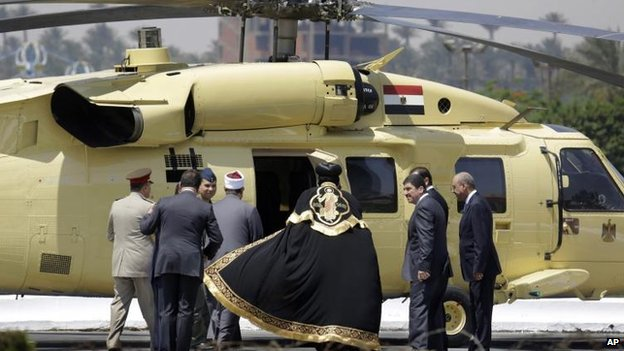 Coptic Pope Tawadros II gets in a military helicopter after he attending the inauguration, 8 June