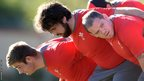 Wales' front row for Tuesday's clash against Eastern Province Kings: Rhodri Jones, Scott Baldwin and Paul James during training.