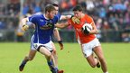 Cavan's Rory Dunne prepares to challenge Armagh's Stefan Campbell