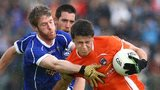 Armagh's Stefan Campbell attempts to burst away from Cavan's Rory Dunne at the Athletic Grounds