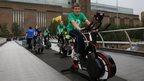 Lambeth school children ride static bikes on the Millennium Bridge