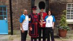 Baton bearers Brian at Rebecca at the Tower of London with a Yeoman and soldier