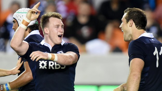 Stuart Hogg celebrates with team-mate Tim Visser in Houston