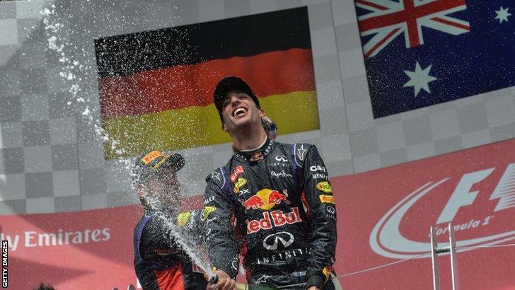 Red Bull Racing's Australian driver Daniel Ricciardo celebrates with teammate Sebastian Vettel