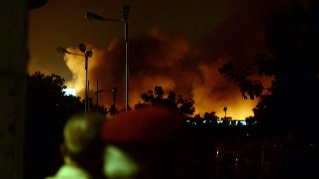 "Smoke rises from the Karachi airport terminal after the militants"" assault in Karachi late on 8 June 2014"