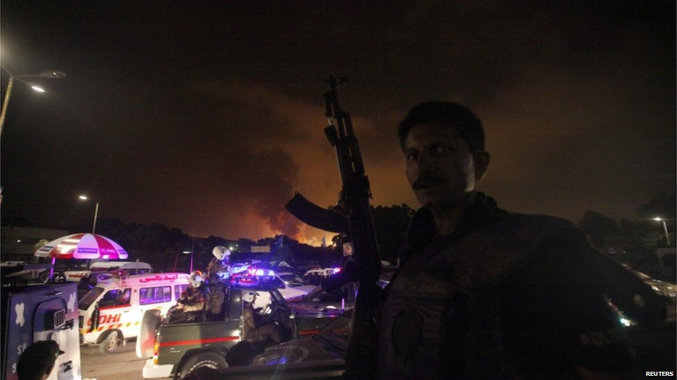 A policeman with a gun stands guard near Karachi's airport