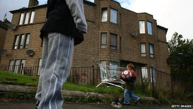 A child playing football in the Govan area of Glasgow