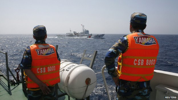 Officers of the Vietnamese Marine Guard monitor a Chinese coast guard vessel on the South China Sea, in this 15 May, 2014 file photo