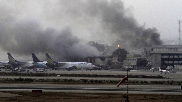 Smoke billows from Jinnah International Airport in Karachi.