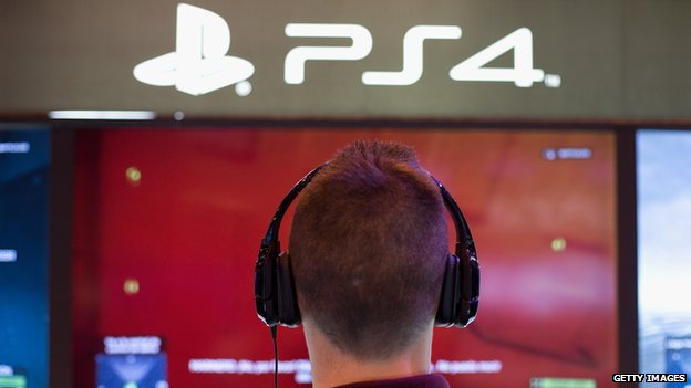 Man looking at Sony's PS4 consoles